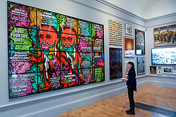 """© Licensed to London News Pictures. 08/06/2017. London, UK. A visitor views """"Beard Speak"""", 2016, by Gilbert & George. Preview of the Summer Exhibition 2017 at the Royal Academy of Arts in Piccadilly.  Co-ordinated by Royal Academician Eileen Cooper, the 249th Summer Exhibition is the world's largest open submission exhibition with around 1,100 works on display by high profile and up and coming artists.<br />  Photo credit : Stephen Chung/LNP"""