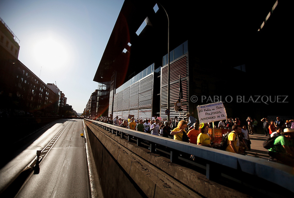 Protesters demonstrate in Madrid on October 15, 2011 during a protest against the global economic crisis. Meanwhile there is not traffic in streets around Atocha. Organizers claim 950 protests held in over 80 countries. Spain.