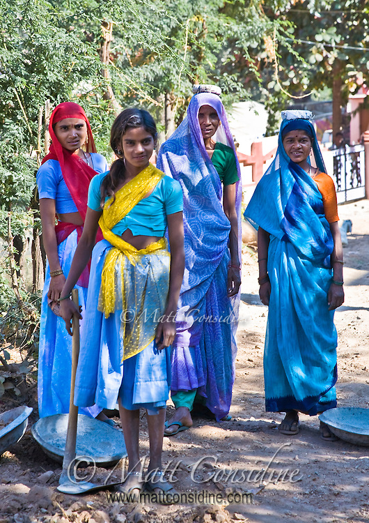 In countryside India, women in colorful saris often work on road building or maintenance projects.<br /> (Photo by Matt Considine - Images of Asia Collection)
