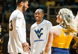 Nov 23, 2015; Morgantown, WV, USA; West Virginia Mountaineers guard Jevon Carter (center) jokes with forward Esa Ahmad before their game against the Bethune-Cookman Wildcats at WVU Coliseum. Mandatory Credit: Ben Queen-USA TODAY Sports