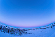 The Earth shadow rising in the southeast with th Belt of Venus above on a clear evening at the Churchill Northern Studies Centre, Churchill, Manitoba, January 25, 2017. With the 12mm Rokinon full-frame fish-eye lens in a single exposure.