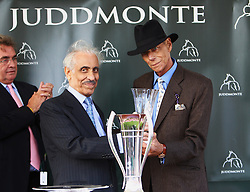 Sir Henry Cecil, 10-time champion trainer, has died at the age of 70.<br /> Responsible for 25 British Classic winners, Cecil was also the leading handler at Royal Ascot with a record 75 successes.<br /> Sir Henry Cecil [right] and Prince Khaled Abdulla at the presentation after Frankel had won the Juddmonte International Stakes at York. 22/8/2012.<br /> Photo by: Racingfotos.com / i-Images.