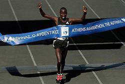 November 13, 2016 - Athens, Attica, Greece - Luka Lobuwan from Kenya, crosses the finish line winning the 34th Athens Classic Marathon, at the Panathenaic stadium in Athens, Greece, on Sunday November 13, 2016. (Credit Image: © Panayiotis Tzamaros/NurPhoto via ZUMA Press)