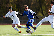 Mount Anthony's Carter Bentley (9) runs past Burlington's Jonas Lobe (22) with the ball during the quarterfinal boys soccer game between Mount Anthony and Burlington at Buck Hard Field on Friday afternoon October 23, 2015 in Burlington. (BRIAN JENKINS/ for the FREE PRESS)
