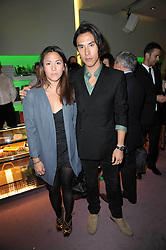 EDWARD TANG and his sister VICTORIA TANG at a party hosted by Prada to celebrate launch of a book documenting the company's diverse projects in fashion, architecture, film and art held at their store 16/18 Old Bond Street, London on 19th November 2009.