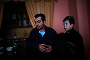 Reshat Zatriqi, 48, sits in his home in Mitrovica with his son. He is worried about the violence that happens near his house in northern Mitrovica in one of the only Albanian neighborhoods. On December 30 2008 a nearby store was burned and on February 14 2009 there was a bomb or grenade explosion at a friend's house a few hundred meters away...Mitrovica, February 15, 2009.