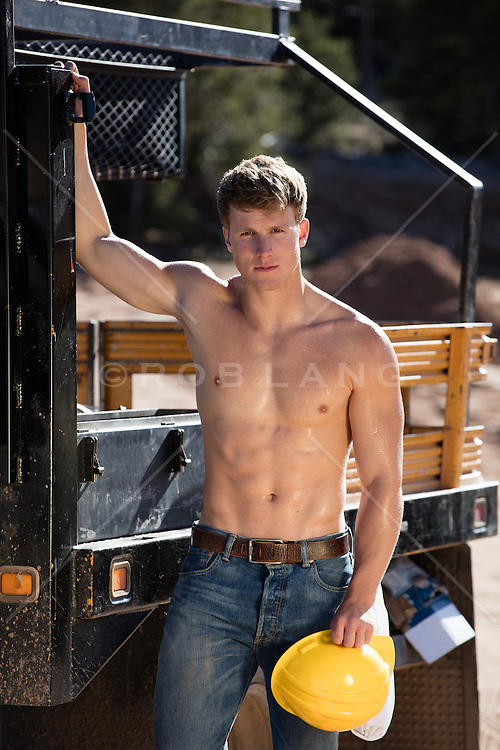 shirtless muscular construction worker on a work site