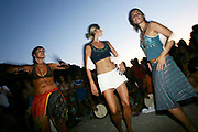 Three cute hippy girls dancing, Sunset beach party, Benirras Beach, Ibiza, July 2006