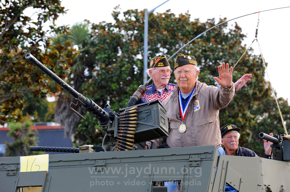 Veterans ride a vintage armored personnel carrier during Monday's 3rd Annual Monterey County Veterans Parade in Salinas.