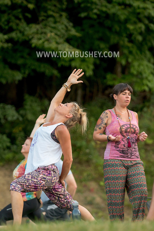Westtown, New York - Elisa Piscitelli, right, of Wild Soul Yoga Studio leads a sunset yoga session at Westtown Brew Works on July 21, 2016.