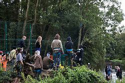 National Eviction Team enforcement agents monitor activists from HS2 Rebellion trying to prevent or delay tree cutting in conjunction with the HS2 high-speed rail link in Denham Country Park on 7 September 2020 in Denham, United Kingdom. Anti-HS2 activists continue to campaign and take direct action against the controversial £106bn project for which the construction phase was announced on 4th September from a series of protection camps based along the route of the line between London and Birmingham.