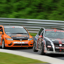 May 23, 2009; Lakeville, CT, USA; The APR Motorsport Volkswagen GTI driven by Ian Baas and Josh Hurley lifts a wheel while turning into  at West Bend while leading the Grand-Am Koni Sports Car Challenge series competition during the Memorial Day Road Racing Classic weekend at Lime Rock Park.