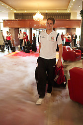 NOVI SAD, SERBIA - Monday, September 10, 2012: Wales' David Edwards walks through dry ice and bubbles as the Hotel Park welcomes the players to Novi Sad ahead of the 2014 FIFA World Cup Brazil Qualifying Group A match against Serbia. (Pic by David Rawcliffe/Propaganda)