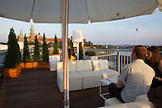 Poland, Krakow. Sunset at the banks of the Wisla and Wawel (castle) seen from the roof terrace of Sheraton Hotel.