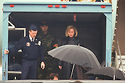 Hillary Clinton watches as President Bill Clinton is carried to his vehicle after suffering a torn ligament in his right knee March 14, 1997. The president's injury came during a visit to the home of golf pro Greg Norman in Hobe Sound, Fla.