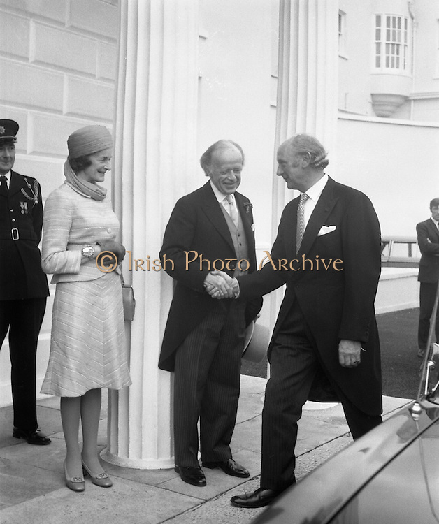 President Childers Inaugerated     (F26)..1973..25.06.1973..06.25.1973..25th June 1973..After his inaugeration President Childers returned to take up residence in Áras an Uachtaráin,Phoenix Park, Dublin..Pictured on his arrival at Áras an Uachtaráin,.President ErskineChilders is congratulated by .An Tanaiste, Mr Jack Lynch TD. Mrs Rita Childers looks on.