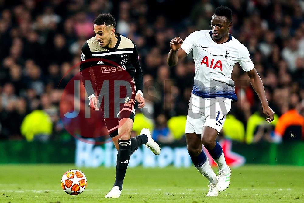 Noussair Mazraoui of Ajax takes on Victor Wanyama of Tottenham Hotspur - Mandatory by-line: Robbie Stephenson/JMP - 30/04/2019 - FOOTBALL - Tottenham Hotspur Stadium - London, England - Tottenham Hotspur v Ajax - UEFA Champions League Semi-Final 1st Leg