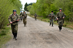 Reenactors from Northern World War Two Association, dressed as elements of the Elite Gross Deutschland Division advance along a dirt road during a private 24hr excerise, held at Sutton Grange, near Ripon in Yorkshire 15  May 2010 .Images © Paul David Drabble.