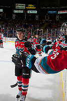 KELOWNA, CANADA - OCTOBER 13: Kyle Topping #24 of the Kelowna Rockets skates to the bench to celebrate a goal against the Calgary Hitmen on October 13, 2017 at Prospera Place in Kelowna, British Columbia, Canada.  (Photo by Marissa Baecker/Shoot the Breeze)  *** Local Caption ***