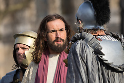 Trafalgar Square, London, March 25th 2016. Thousands of Londoners an tourists in Trafalgar Square are treated to The Passion of Jesus, a re-enactment of the events leading up to the crucifixion and resurrection of Jesus Christ. PICTURED: Jesus is tried. <br /> &copy;Paul Davey<br /> FOR LICENCING CONTACT: Paul Davey +44 (0) 7966 016 296 paul@pauldaveycreative.co.uk