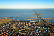 Nederland, Noord-Holland, Den Oever, 11-12-2013; Afsluitdijk met Stevinsluizen gezien vanuit Den Oever. Haven Den Oever, links Waddenzee, rechts IJsselmeer. <br /> Enclosure Dam with Stevin Locks seen from Den Oever. Port of Den Oever, left Waddenzee, IJsselmeer right.<br /> luchtfoto (toeslag op standaard tarieven);<br /> aerial photo (additional fee required);<br /> copyright foto/photo Siebe Swart.