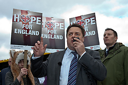 © licensed to London News Pictures. Hyde, UK  25/02/2012. Nick Griffin at a BNP rally in Hyde. The EDL demonstrate following an assault on Daniel Stringer-Prince. The victim's family said they did not want the EDL to demonstrate in their town in their son's name. It is alleged he was assulted by a gang of Asian men. At the same time, the BNP hold a rally in the town. Photo credit should read Joel Goodman/LNP