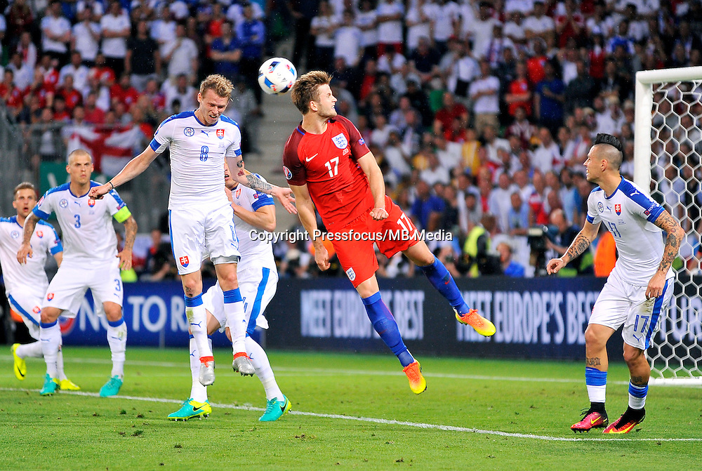 2016.06.20 Saint Etienne<br /> Pilka nozna Euro 2016<br /> mecz grupy B Slowacja - Anglia<br /> N/z Ondrej Duda Eric Dier<br /> Foto Norbert Barczyk / PressFocus<br /> <br /> 2016.06.20 Saint Etienne<br /> Football UEFA Euro 2016 group B game between Slovakia and England<br /> Ondrej Duda Eric Dier<br /> Credit: Norbert Barczyk / PressFocus