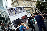 Frankfurt am Main | 30 Aug 2014<br /> <br /> Am Samstag (30.08.2014) demonstrierten &uuml;ber 200 Aktivisten aus dem Umfeld der Partei &quot;Die Linke&quot; und anderen linken und linksradikalen Zusammenh&auml;ngen gegen Krieg und f&uuml;r Frieden. Einige ukrainische Nationalisten und Aktivisten der dubiosen Montagsmahnwache in Frankfurt hatten sich unter die Friedensdemonstranten gemischt.<br /> Hier: Eine Aktivistin tr&auml;gt ein Plakat mit Fotos des Massakers von Odessa am 2. Mai 2014.<br /> <br /> &copy;peter-juelich.com<br /> <br /> [No Model Release | No Property Release]