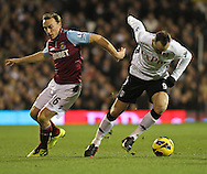 Picture by David Horn/Focus Images Ltd +44 7545 970036.30/01/2013.Dimitar Berbatov (right) of Fulham and Mark Noble (left) of West Ham United during the Barclays Premier League match at Craven Cottage, London.