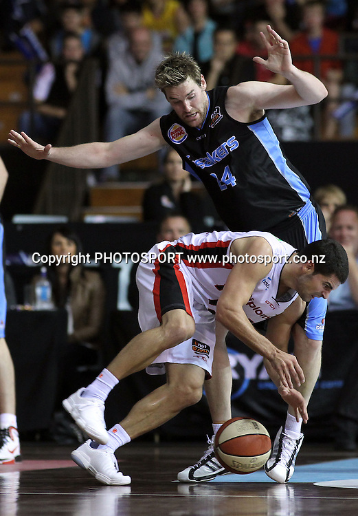 Breakers' Dillon Boucher pressures on a falling Wildcats' Kevin Lisch. iinet ANBL, Semi-Finals Game 1, New Zealand Breakers vs Perth Wildcats, North Shore Events Centre, Auckland, New Zealand. Thursday 7th April 2011. Photo: Anthony Au-Yeung / photosport.co.nz