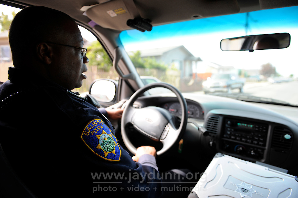 Salinas police officers Jeffrey Lofton, pictured, on patrol with partner Richard Lopez as part of the Community Alliance for Safety and Peace. CASP is an ambitious program that aims to steer youth away from gang violence and toward solutions offered by more than 30 local organizations offering alternatives.