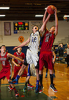 Winnisquam's Michael Buxton and Belmont's Andrew Derosia go up for the rebound during the boys semi final in the 41st annual Holiday Basketball Tournament at Gilford High School.  (Karen Bobotas/for the Laconia Daily Sun)