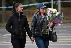 © Licensed to London News Pictures. 10/11/2016. Croydon, UK. Women arrive to place floral tributes near the overturned tram at Sandilands station. Investigations are continuing into a tram crash that police say claimed seven lives and injured 50. The driver has been arrested and is being questioned by police. Photo credit: Peter Macdiarmid/LNP