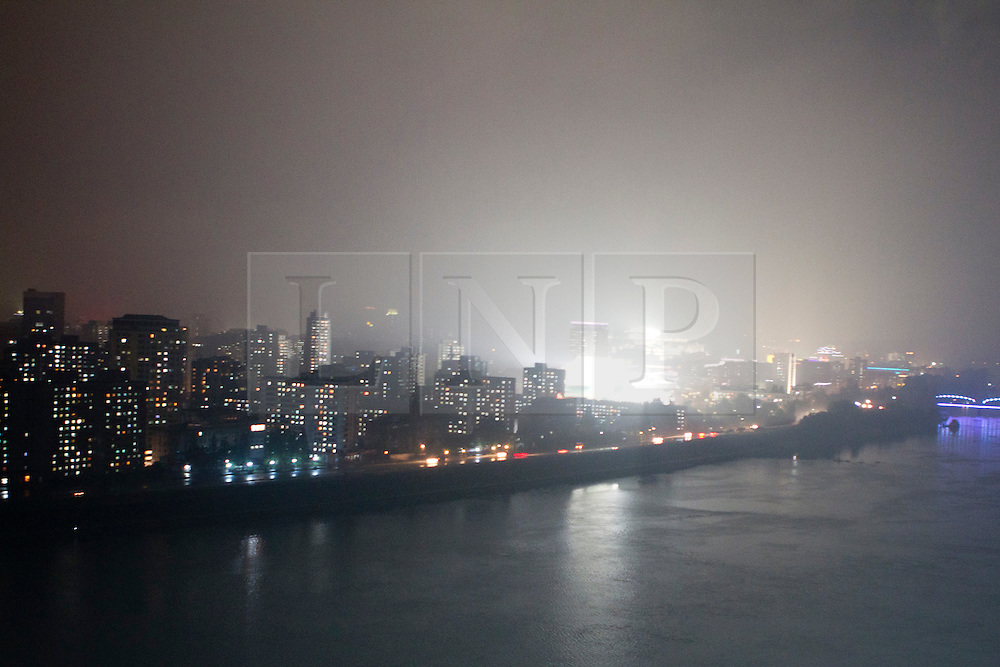 © Licensed to London News Pictures. 10/08/2011. Pyongyang, North Korea. A general view of Pyongyang at night.  The bright area is Kim Il Sung square, which regularly hosts military parades and party rallies. Photo credit : James Gourley/LNP/