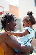 Crushow Herring  and his daughter Serenity sharing a moment during a Skid Row Streetball League basketball game