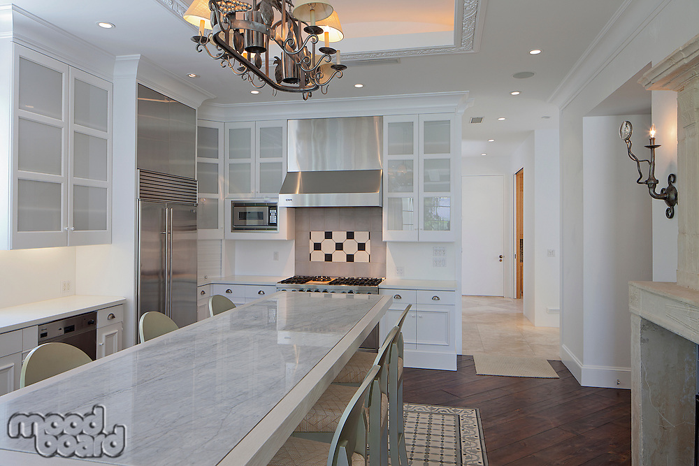 Dining table and chair in modern kitchen of luxury villa