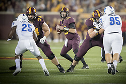 August 31, 2017 - Minneapolis, MN, USA - Minnesota quarterback Conor Rhoda, middle, looks downfield to pass during the fourth quarter against Buffalo at TCF Bank Stadium in Minneapolis on Thursday, Aug. 31, 2017. The host Golden Gophers won, 17-7. (Credit Image: © Elizabeth Flores/TNS via ZUMA Wire)