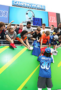 Jan 28, 2018; Orlando, FL, USA; NFC running back Todd Gurley of the Los Angeles Rams (30) signs autographs for fans before playing in the 2018 NFL Pro Bowl at Camping World Stadium. The AFC defeated the NFC 24-23. (Steve Jacobson/Image of Sport)