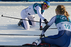 February 25, 2018 - Pyeongchang, South Korea - Silver medalist KRISTA PARMAKOSKI of Finland congratulates bronze medalist STINA NILLSON of Sweden (bib 19 ) at the conclusion of the Ladies' 30km Mass Start Classic cross-country ski racing event in the PyeongChang Olympic Games. (Credit Image: © Christopher Levy via ZUMA Wire)