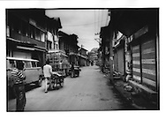 Eery quiet: Empty streets and shuttered shops on anniversary of 13 July 1931 massacre of 21 Kashmiris at from the bullets of Hindu soldiers.  Few Srinagar residents venture out for fear of violent clashes between Kashmiri separatists and Indian soldiers.  The Indian military occupation of the predominantly Muslim region has resulted in the death of over 80,000 Kashmiris.