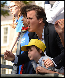 Image ©Licensed to i-Images Picture Agency. 05/07/2014. Yorkshire, United Kingdom.The Prime Minister David Cameron and his son Elwen reacts to Mark Cavendish crashing off his bike in the Tour de France finish line in Harrogate on stage one of the race after a fall  just  short of the finish line . Picture by Andrew Parsons / i-images