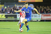 AFC Wimbledon defender Jon Meades (3) dribbling during the The FA Cup match between AFC Wimbledon and Lincoln City at the Cherry Red Records Stadium, Kingston, England on 4 November 2017. Photo by Matthew Redman.