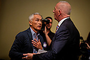 """Univision reporter Jorge Ramos, left, is escorted from Presidential candidate Donald Trump's press conference before his """"Make America Great Again Rally"""" at the Grand River Center in Dubuque, Iowa, Tuesday, August 25, 2015. Ramos, an anchor with the Spanish-language Univision network, was removed from Donald Trump's news conference in Dubuque, Iowa, on Tuesday after the Republican presidential candidate said the journalist was asking a question out of turn. Ramos, who later returned to the televised event, was trying to query Trump about immigration when the real estate mogul told him several times to sit down. REUTERS/Ben Brewer"""