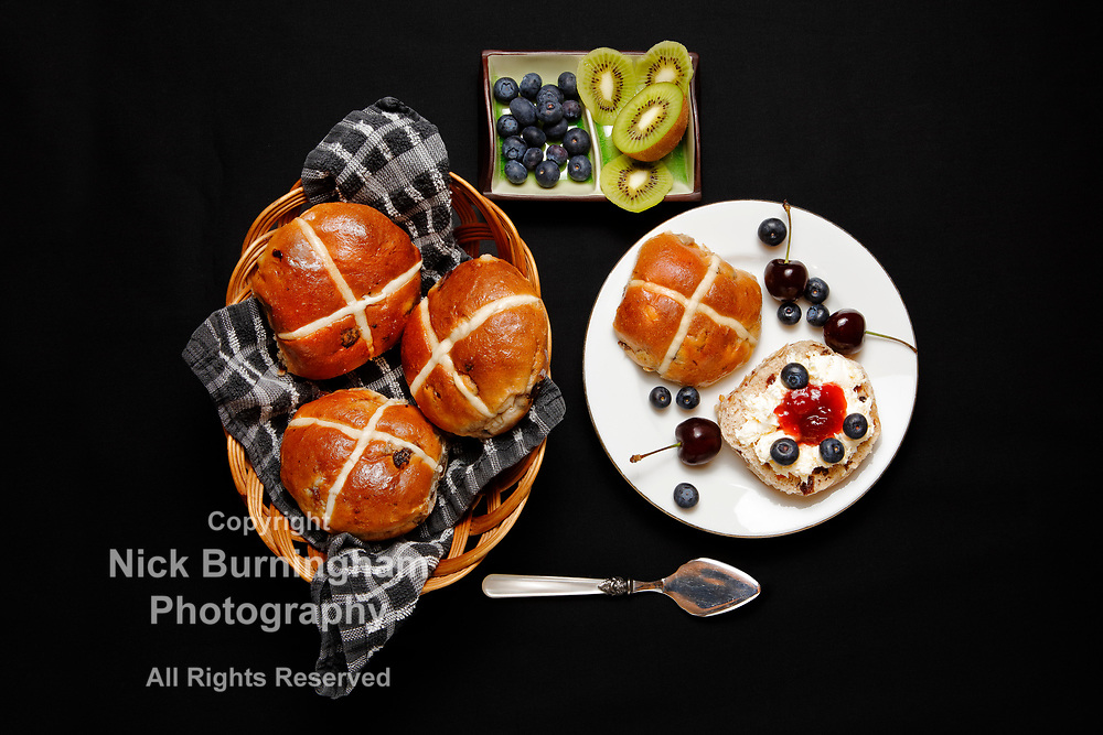 Easter Hot Cross Buns with jam, clotted cream, blueberries and kiwi Contact us for Royalty Free options for this image