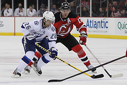 Mar 29; Newark, NJ, USA; Tampa Bay Lightning right wing Martin St. Louis (26) skates with the puck while being defended by New Jersey Devils left wing Ilya Kovalchuk (17) during the second period at the Prudential Center.