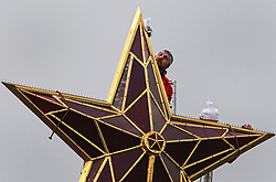 Workers cleaning the star on the top of Vodovzvodnaya tower of Moscow Kremlin, Russia 29 May 2009.The stars were placed on Kremlin towers by Bolsheviks replacing Tzar's two-headed eagles and the biggest are 3.75 meters from end to end.