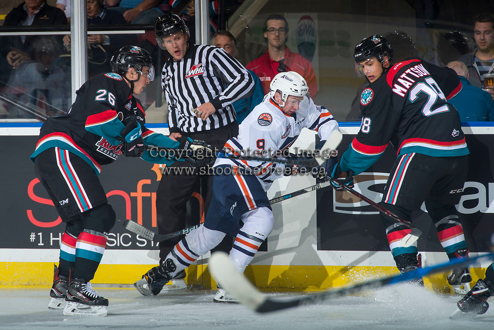 KELOWNA, CANADA - SEPTEMBER 22: Linesman Dustin Minty backs away from Jackson Shepard #9 of the Kamloops Blazers as Liam Kindree #26 and Leif Mattson #28 of the Kelowna Rockets check at the boards on September 22, 2017 at Prospera Place in Kelowna, British Columbia, Canada.  (Photo by Marissa Baecker/Shoot the Breeze)  *** Local Caption ***