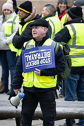 "© Licensed to London News Pictures . 05/01/2019. Manchester, UK. A man carrying a Stop Brexit Betrayal placard . A Yellow Vest demonstration takes place in St Peter's Square in central Manchester . The protest was organised via YouTube account "" Tommy Robinson News "" and was called in the wake of stabbings at Manchester Victoria Train Station on New Year's Eve . Protesters chanted in favour of Brexit , against police and press and carried pro-Trump and EDL clothing and placards . Photo credit : Joel Goodman/LNP"