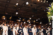 Students toss their caps at the end of the Oakwood High School 88th annual commencement at the Dayton Convention Center in downtown Dayton, Monday, June 4, 2012.