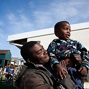 The Stars Foundation visiting Home from Home in Cape Town, South Africa...Here a father is visiting his son at one of the homes. The father and son live close to each other but the father is not able to care  for his son. Home from Home is bridging the gap and providing a safe environment in which the boy can grow...Home from Home provide security for children who are either orphans or have been abandoned, neglected or abused . Many of the children have suffered severe abuse and more than half are HIV positive. Home from Home set up foster homes of no more than six children in local communities where there is a need and employ women to run the homes and become the registered foster mother of the children.